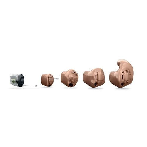 five different custom hearing aids lined up left to right