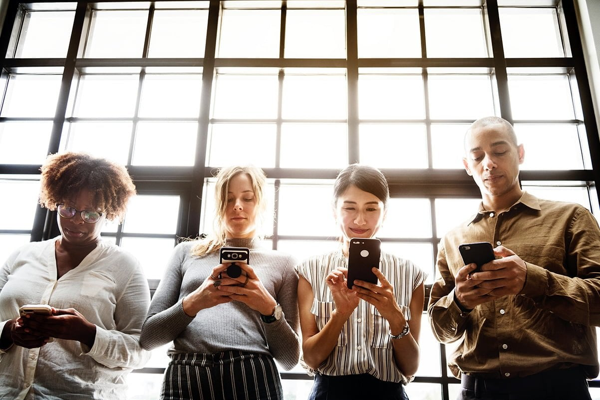 A group of people using an app on a smartphone